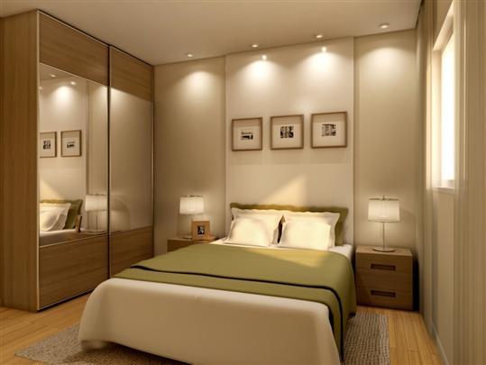 490889-O-uso-de-espelhos-e-lâmpadas-embutidas-amplia-o-quarto.